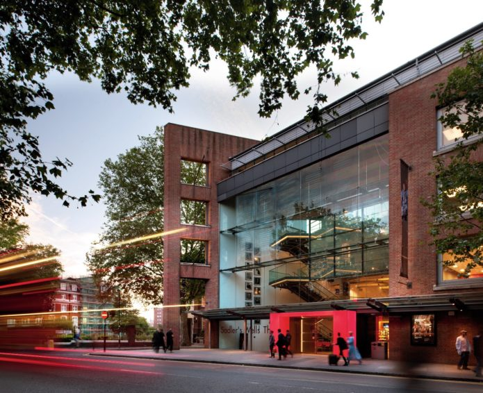 Sadler's Wells Theatre in Angel, on an early evening, as pedestrians walk by.
